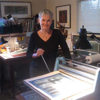 Anne Moore at work in her printmaking studio